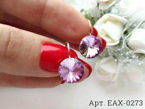 Cерьги c кристаллами Swarovski EAX-0273 на цветочном фоне