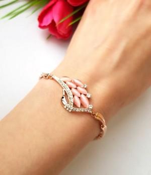 Браслет позолоченный с розовым камнем и чешским стеклом