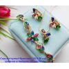 Набор позолоченной бижутерии в виде цветов с цветными фианитами
